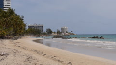 TROPICAL SANDY BEACH:  apartments Isla Verde tourist sector 6 - stock footage