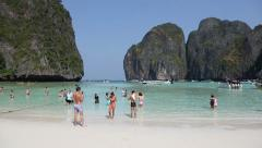 Tropical Paradise, Tourists on the beach Maya bay Phi Phi Leh, Thailand Stock Footage