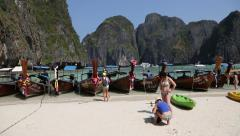Traditional Thai boats at Maya bay Phi Phi Leh island, Thailand Stock Footage