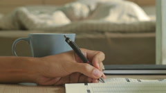 Man writing on a book and go to sleep on the bed Stock Footage
