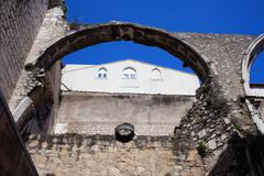 Arch in Ruins of Carmo Convent in Lisbon - stock photo