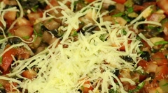 Sprinkling of grated cheese food Stock Footage
