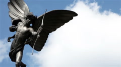 The Statue of Eros, in Piccadilly Circus, London, UK; time lapse with copy space Stock Footage
