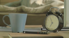 Man waking up by alarm clock and he writing for unfinished work. Stock Footage