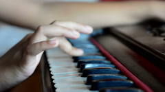 Close shot of playing harmonium a musical instrument. Stock Footage