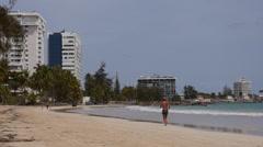 BEACH RUNNER-JOGGER:  apartments Isla Verde tourist tropical sandy beach 4 Stock Footage