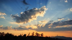 Beautiful scenic sunset with rays of sun shining through clouds 4K UHD Timelapse Stock Footage