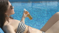 Young woman using sunblock spray for skin wellness, medicine Stock Footage