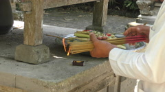 Lighting incense sticks in Bali Temple Stock Footage