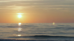Time lapse of sun setting over the Baltic sea, cirrus clouds - stock footage
