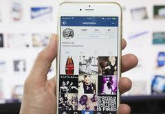 Stock Photo of Iphone showing Instagram account of Madonna