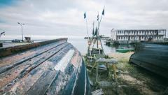Time lapse of a fishing village and fishing boats Stock Footage