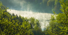 Time lapse of fast rising mist from a river Stock Footage