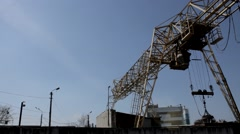 Overhead gantry crane loads metal wreckage at scrap yard Stock Footage