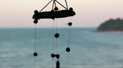 Wind chimes moving in the wind - stock footage