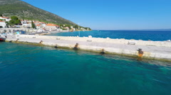 Aerial view of small lighthouse in Bol harbour on the island of brac, Croatia. Stock Footage