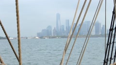 An old ship passes into New York Harbor - stock footage