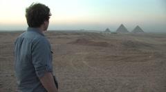 Young Man Looking at Pyramids of Giza Stock Footage