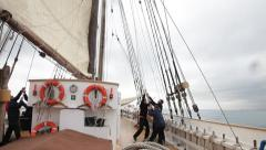 Hoisting sails on the deck of an ancient sailboat Stock Footage