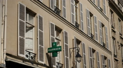 Paris apartment building with sign 'Pharmacie' - stock footage