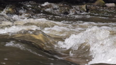 Slow motion close-up of a wave in river rapids - stock footage