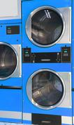 Automatic dryers coin operated in the laundromat - stock photo