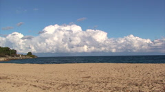 Saint Tropez beach with storm in sky, Timelapse pan left - stock footage