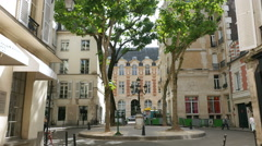 Quiet little square with trees in Paris, France Stock Footage