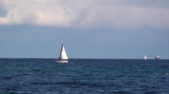 Small sailing boat advances to Saint Tropez port Stock Footage