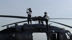 White Shirt Personnel on Aircraft Carrier Helicopter Stock Footage