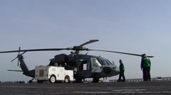 Helicopter on Flight Deck Preparing for Take Off Stock Footage