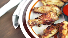 Appetizer plate with wood fired oven chicken wings. - stock footage