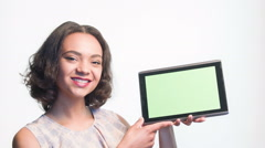 Smiling girl showing on her tablet Stock Footage