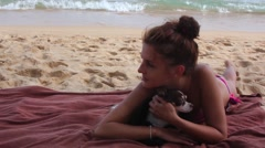 Beautiful Young Woman and Her Dog Chihuahua lay on The Beach Arkistovideo