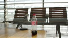 Cola bottle on table Stock Footage