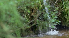 Slow motion closeup of a small waterfall Stock Footage