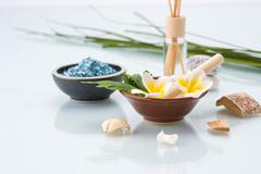 Spa concept with Mortar and Pestle, Flowers, leaf, Scented, and salt Stock Photos