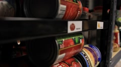 Tracking Shot of Products Being Placed on Storage Shelf Stock Footage