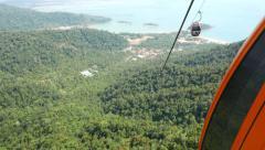 Move up within gondola lift, Langkawi SkyCab, lowland sunny panorama Stock Footage