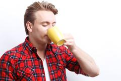 Agreable guy drinking tea Stock Photos