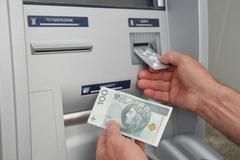 Hand of a man using banking machine Stock Photos