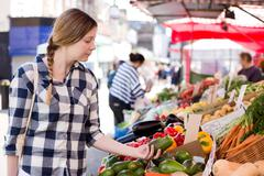 young woman shopping for food at the market - stock photo