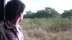 A Young Man Rides in a Safari Truck in the South Luangwa National Park Stock Footage