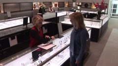 Woman looking at jewelry Stock Footage