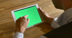 4K Man Using Tablet Green chroma-key Screen Various Swiping Close-Up Stock Footage