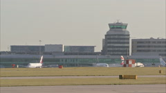 Manchester Airport GV with plane through frame 1920x1080 Stock Footage
