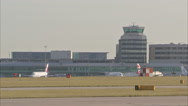 Stock Video Footage of Manchester Airport GV with plane through frame 1920x1080