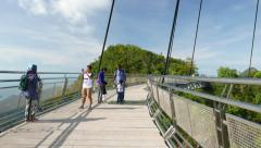 Tourist enjoy picturesque views from SkyBridge, POV move on walkway along bridge Stock Footage