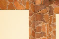 Yellow stone wall with plaster Stock Photos