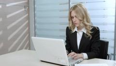 Manager works in the office. Business lady working at the computer. Stock Footage